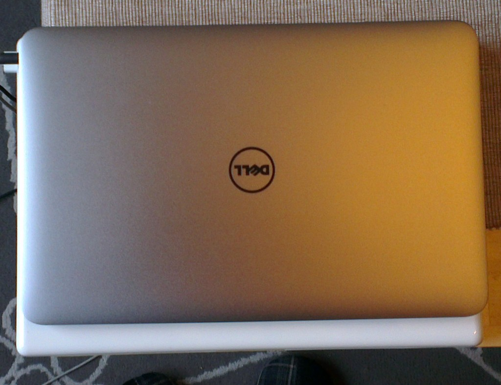 Dell XPS13 on top of my Macbook 2.1. Bit smaller. A lot lighter.